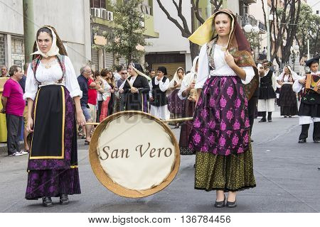 QUARTU S.E., ITALY - September 21, 2014: Parade of Sardinian costumes and floats for the grape festival in honor of the celebration of Sant'Elena.- group of girls in san vero milis