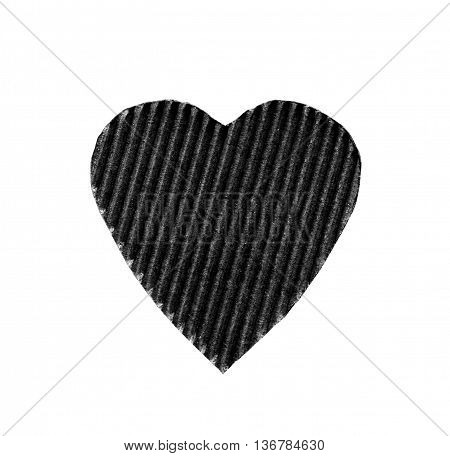 the symbol of a heart cut from corrugated cardboard black color isolated on white background. the concept of love Valentine's day