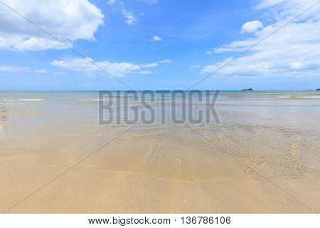 Beach at tropical sea with white cloud and blue sky