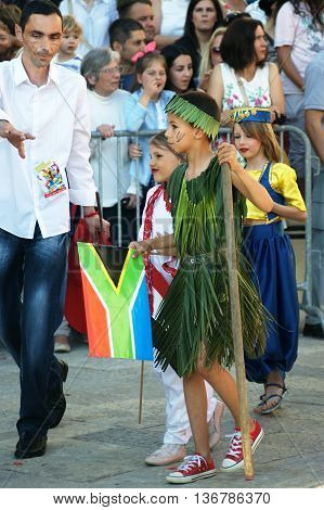 Montenegro, Herceg Novi - 04/06/2016: Boy in a suit made of palm leaves, representing the South African resident. 10 International Children's Carnival