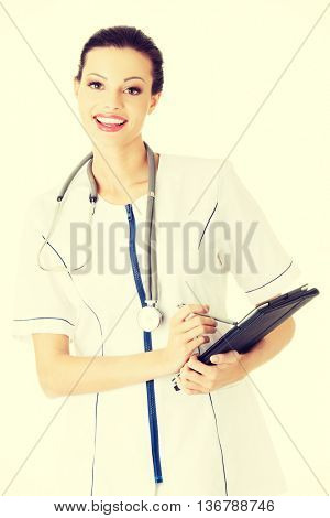 Female doctor using tablet computer