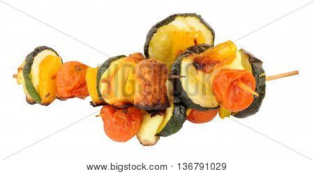 Grilled Halloumi cheese and vegetable kebabs on wooden skewers isolated on a white background