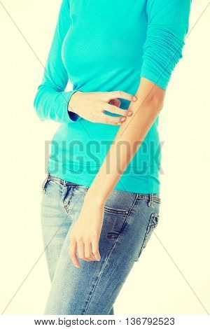 Young woman scratching her self.