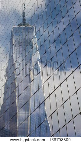 NEW YORK CITY, USA - SEPTEMBER 28, 2015: Reflection of the Freedom Tower in an office building