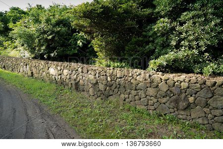 the long wall made in Korea with gray moutain stone.