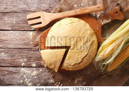Freshly Baked Corn Bread Close-up On A Wooden Board. Horizontal Top View