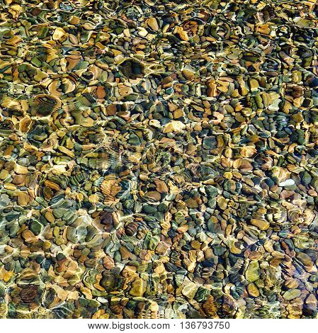 Top View Water Reflection With Stone Pebbles