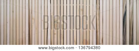 Wooden slats on floor or wall in vertical parallel pattern background panel texture horizontal image