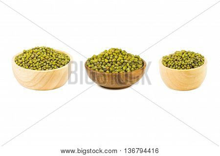 mung beans on wooden cup isolated on white