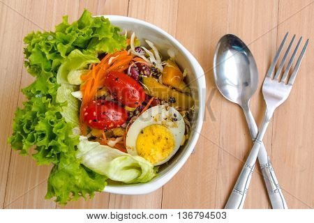 Detail Of Salad With Lettuce, Tomato, Egg And Sesame Sauce, Clean Food And Fresh Vegetable.