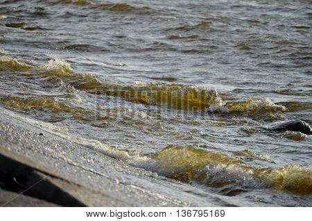 Waves dashing on a concrete beach on the beach