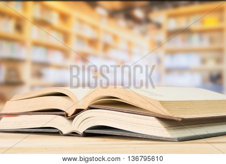 Open book on the desk in library. Education books concept.