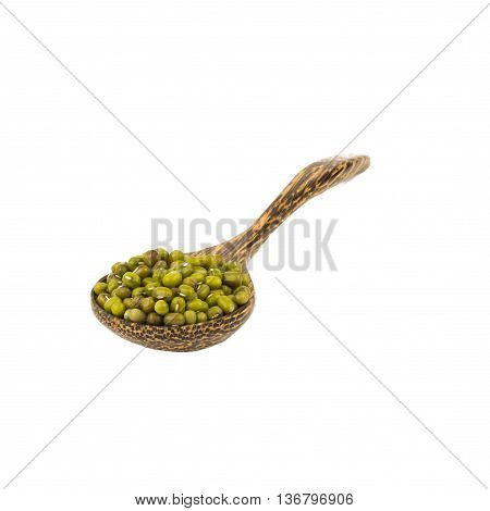 plenty of mung beans on wooden spoon isolated on white