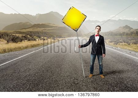 Guy showing roadsign . Mixed media