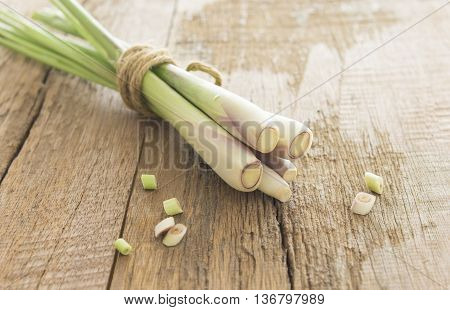 Bundle of lemon grass and sliced on wood table.
