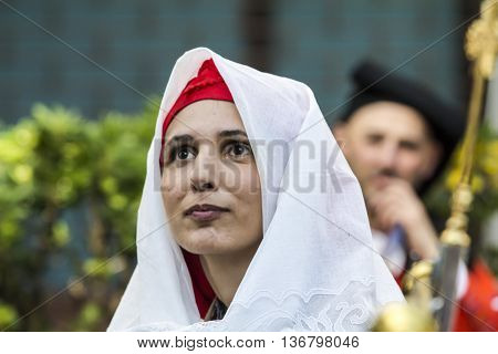 CAGLIARI, ITALY - May 1, 2015: 359 ^ Religious Procession of Sant'Efisio - Sardinia - portrait of a beautiful girl in traditional Sardinian costume