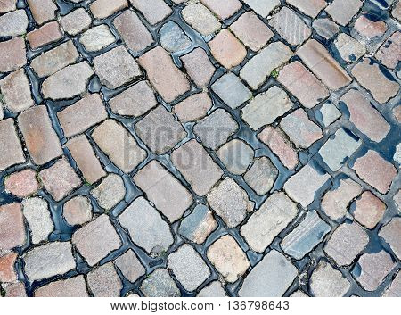 Cobblestone road or street, background or texture