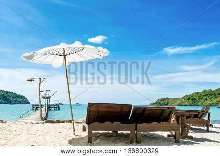 Summer Travel Vacation and Holiday concept - Beach chairs with umbrella and beautiful sand beach on hotel beach lounge in Phuket Thailand