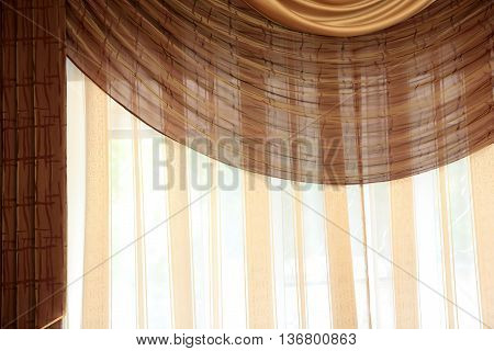 Details of brown curtain in a motel