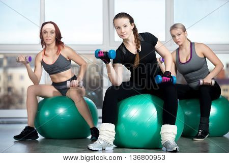 Exercising With Dumbbells On Balls