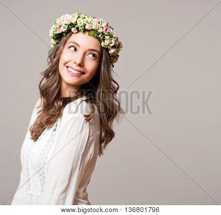 Gorgeous Brunette Woman Wearing Spring Flower Wreath.