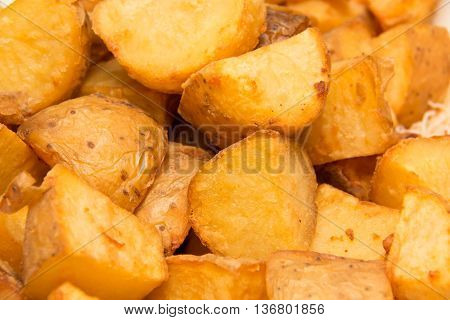 food background full of fried potato wedges background