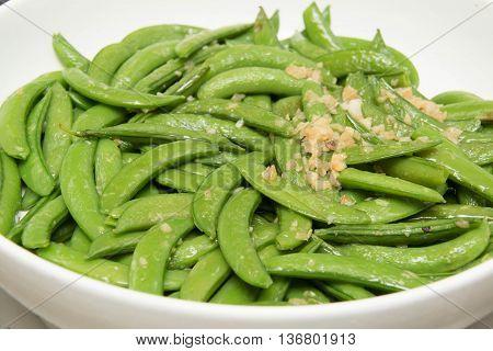 Close up of stir fried vegetables snow peas