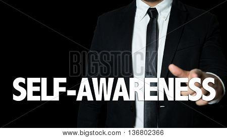 Business man pointing the text: Self-Awareness