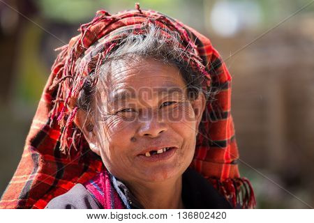 INLE LAKE MYANMAR - JANUARY 12 2016: Unidentified old woman on her smile face is happiness. The local people are hospitable and friendly to tourists