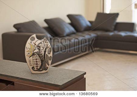 Ornate Vase On A Shelf In Living Room