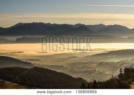 Beautiful sunset in mountains with fog in valleys.Carinthia,Austria.