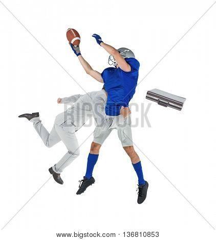 Businessman tackling a football player