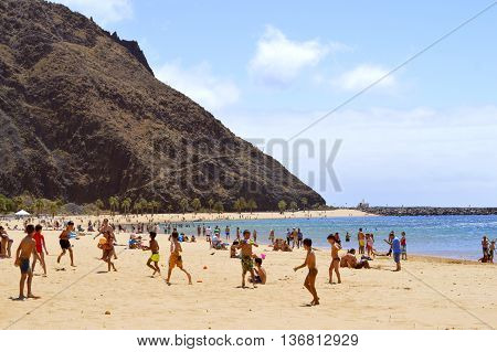 Playa De Las Teresitas beach Tenerife Canary Islands Spain Europe - June 14 2016: Children playing on the beach enjoying the sun