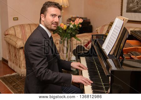 Piano music player dressed in classic suit