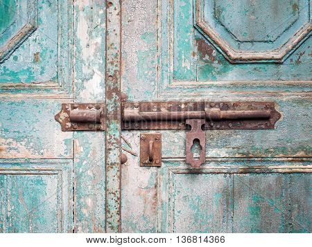 rusted keyhole on wooden door, Close up