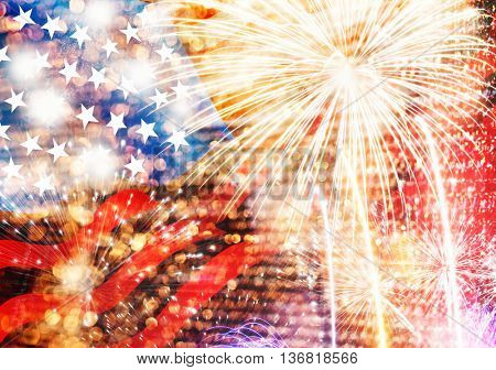 Celebratory fireworks and crowd of people on the background of the US flag. Independence day, 4th of July