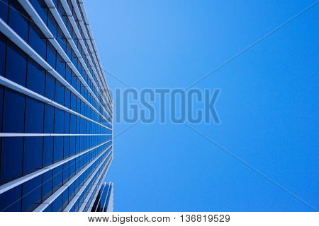 a picture of a very tall building with beautiful architecture which barely waiting to be discovered. a building which rises up to heaven