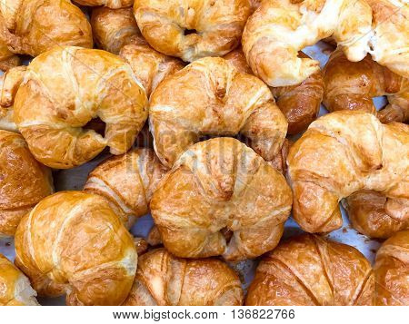 Croissant Bread : a French crescent-shaped roll made of sweet flaky pastry often eaten for breakfast.