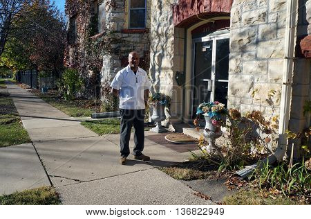 JOLIET, ILLINOIS / UNITED STATES - NOVEMBER 1, 2015: A man smiles for a photograph outside of the Old Central Presbyterian Church, which now serves as a wedding chapel.