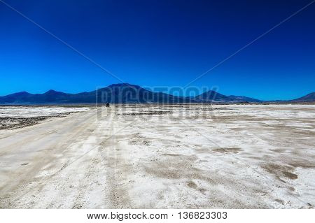 A car driving on a track in the Salt Flats, Bolivia