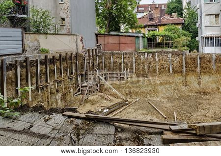 Digging foundation of new construction in the residential district, Sofia, Bulgaria