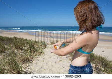 Sunscreen Woman Putting Solar Cream Or Sunblock Smiling Happy In Bikini