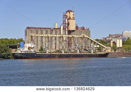 Cargo tanker ship and grain elevators Portland Oregon.