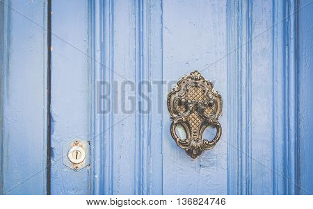 Old Metal Knocker on Blue Wooden door Malta. Space for Your text