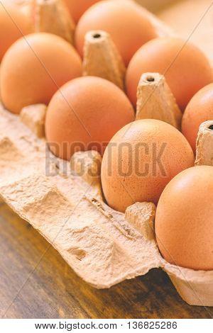 Chicken eggs in box retro toned selective focus