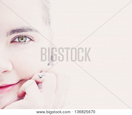 Beautiful woman half-face portrait on light background. Healthy skin concept no make up space for your text