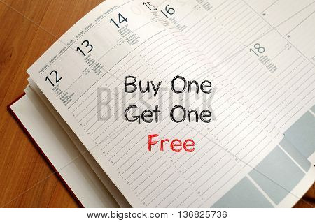 Buy one get one free text concept write on notebook