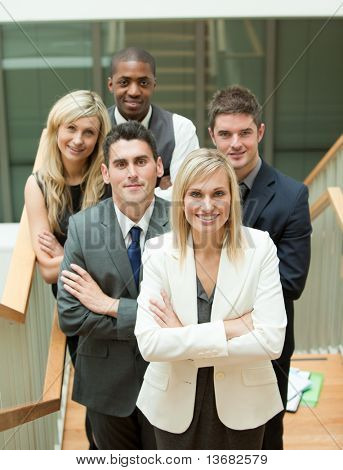 Businesspeople with a woman in the middle in an office