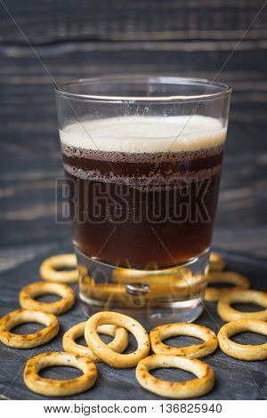 Dark Beer In A Glass On A Wooden Background
