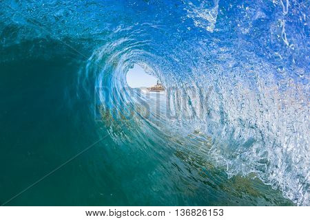 Wave blue tube ocean swimming inside hollow crashing water photo.